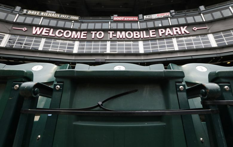 Zip-ties make this seat, and many others, inoperable at T-Mobile Park. Crews applied the ties to maintain social distancing between non-pod seats in preparation for the sold-out opening day on Thursday. (Ken Lambert / The Seattle Times)