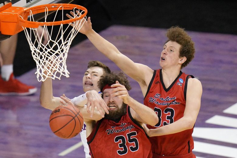 Kansas guard Christian Braun, left, battles Eastern Washington forward Tanner Groves (35) and teammate Jacob Groves (33) for a rebound during the second half in the NCAA  tournament at Farmers Coliseum in Indianapolis, Saturday. (AJ Mast / The Associated Press)