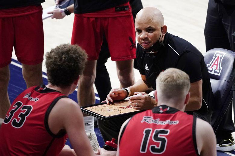Eastern Washington head coach Shantay Legans talks to his players during the second half of a basketball game against Arizona in Tucson, Ariz., on Dec. 5, 2020. (Rick Scuteri / AP)