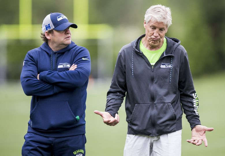 Seahawks Head Coach Pete Carroll shrugs while talking with General Manager John Schneider after Seattle Seahawks minicamp at the Virginia Mason Athletic Center in Renton Thursday June 14, 2018. (Bettina Hansen / The Seattle Times)