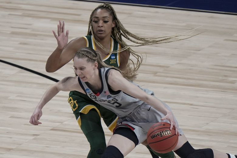 UConn's Paige Bueckers drives past Baylor's DiJonai Carrington during the second half of an NCAA college basketball game in the Elite Eight round of the women's NCAA tournament Monday, March 29, 2021, at the Alamodome in San Antonio. (Morry Gash / The Associated Press)