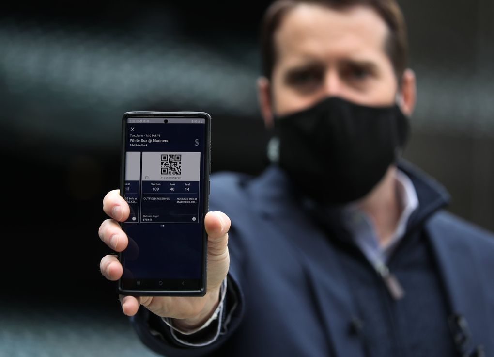 Malcolm Rogel, Mariners Vice President of Ticket Operation and Event Services, shows a digital ticket on his phone, the only way for fans to get into the ballpark, during a news conference about what fans should expect when coming to the ballpark, Wednesday, March 24, 2021 at T-Mobile Park in Seattle. (Ken Lambert / The Seattle Times)