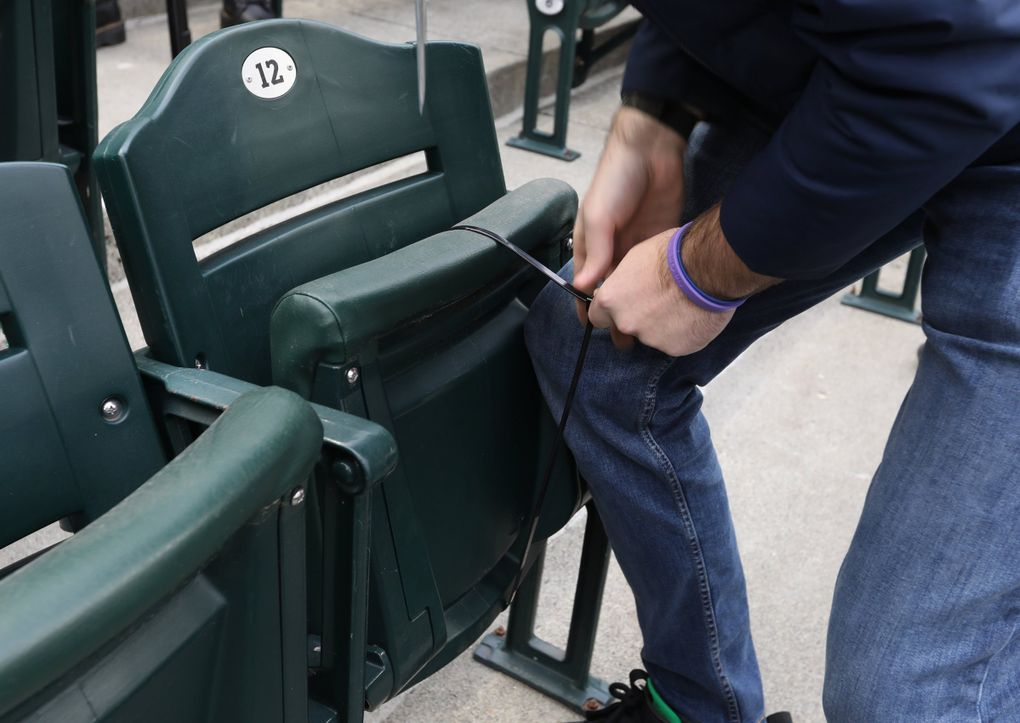 With about a week to go to an already sold-out Opening Night, crews for the Mariners have been zip tying all non-pod seats to make them inoperable during games to maintain social distancing between fans, Wednesday, March 24, 2021 at T-Mobile Park in Seattle. (Ken Lambert / The Seattle Times)