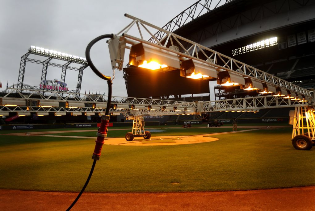 With about a week to go to a sold out Mariners Opening Night, grow lights are seen over the infield Wednesday, March 24, 2021 at T-Mobile Park in Seattle. 216718 (Ken Lambert / The Seattle Times)