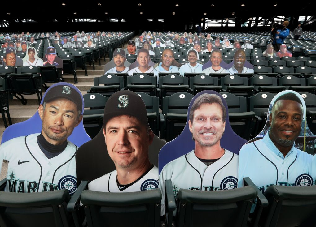 Call it a power-pod, from left, as cutouts of Ichiro, Dan Wilson, Randy Johnson and Ken Griffey Jr. represent a socially-distanced seating configuration staged for the media, along with other pods using cutouts of Mariners players, Baseball Hall of Famers and fans, Wednesday at T-Mobile Park in Seattle. (Ken Lambert / The Seattle Times)