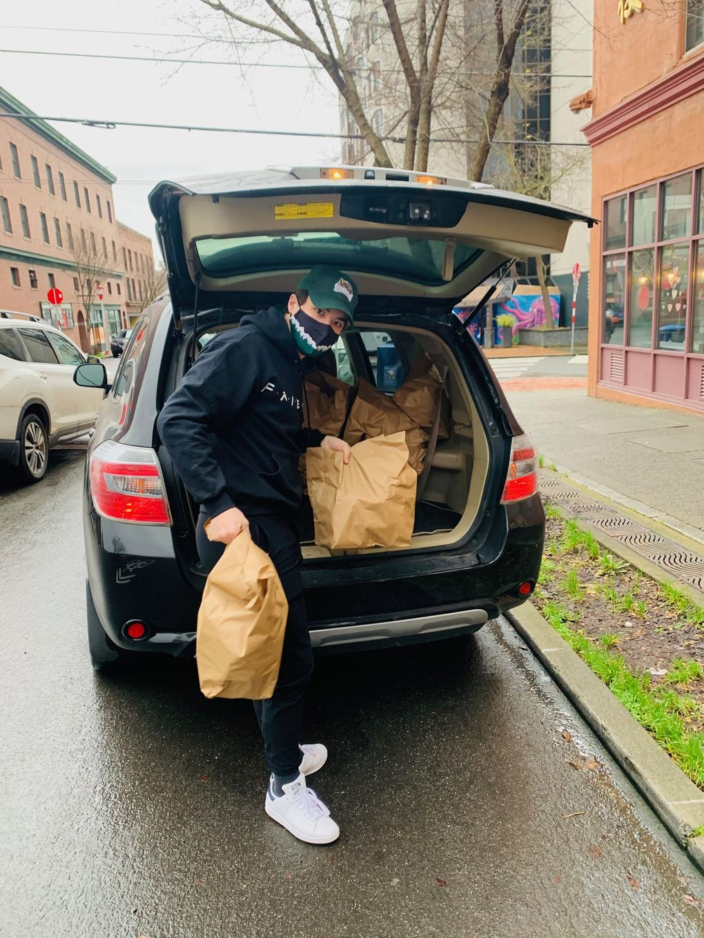 Everett Silvertips forward Brendan Lee delivers groceries last month to elderly residents of Seattle's International District kept homebound by COVID-19 concerns. (Photo courtesy of the Lee family)