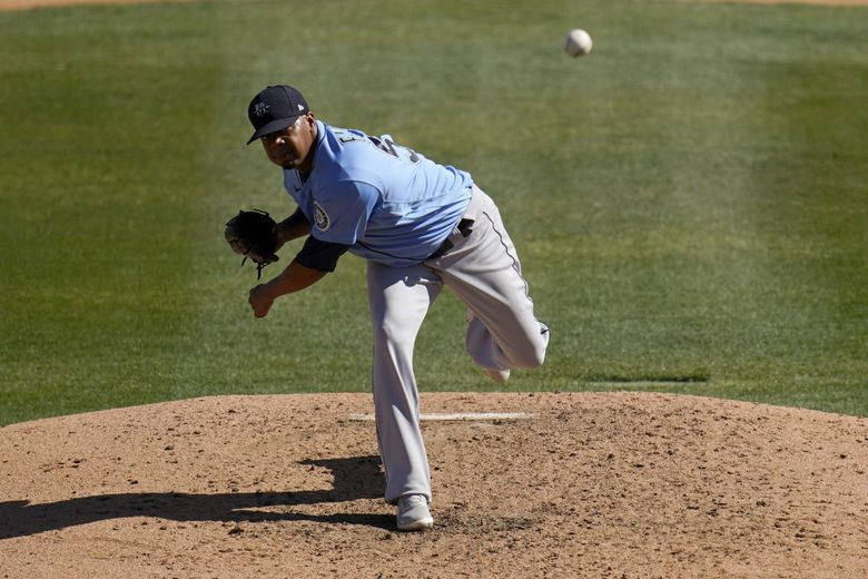 Seattle Mariners pitcher Roenis Elias throws to a Chicago White Sox batter during the fourth inning of a spring training game Friday, March 5, 2021, in Phoenix. (AP Photo/Ross D. Franklin)