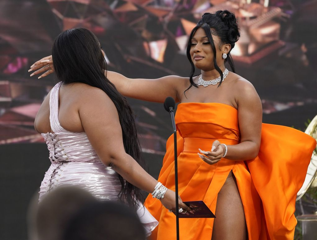 Lizzo, left, presents the award for best new artist to Megan Thee Stallion at the 63rd annual Grammy Awards at the Los Angeles Convention Center on Sunday, March 14, 2021. (Chris Pizzello / Invision / AP)