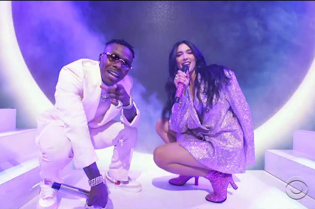 """In this video grab provided by CBS and the Recording Academy, DaBaby, left, and Dua Lipa perform """"Levitating"""" at the 63rd annual Grammy Awards at the Los Angeles Convention Center on Sunday, March 14, 2021. (CBS / Recording Academy via AP)"""