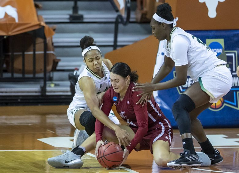 South Florida guard Sydni Harvey (3), left, fights for the ball against Washington State guard Krystal Leger-Walker (4) while South Florida center Shae Leverett (21), right, tries to get in on the play during the second quarter Sunday in the first round of the women's NCAA tournament in Austin, Texas. (Ricardo B. Brazziell / The Associated Press)
