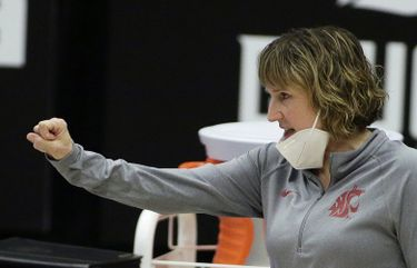 Washington State head coach Kamie Ethridge signals her team during the first half of an NCAA college basketball game against UCLA in Pullman, Wash., Friday, Feb. 5, 2021. (AP Photo/Young Kwak)
