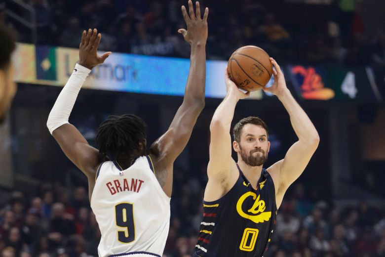 FILE – In this March 7, 2020, file photo, Cleveland Cavaliers' Kevin Love (0) passes against Denver Nuggets' Jerami Grant (9) in the first half of an NBA basketball game in Cleveland. Love's devotion to raising awareness and advocating for mental health during isolating times has earned him another honor. (AP Photo/Tony Dejak, File)
