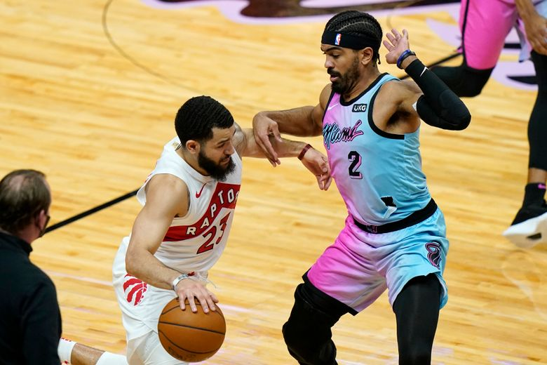 Toronto Raptors guard Fred VanVleet (23) drives to the basket as Miami Heat guard Gabe Vincent (2) defends during the first half of an NBA basketball game, Wednesday, Feb. 24, 2021, in Miami. (AP Photo/Lynne Sladky)