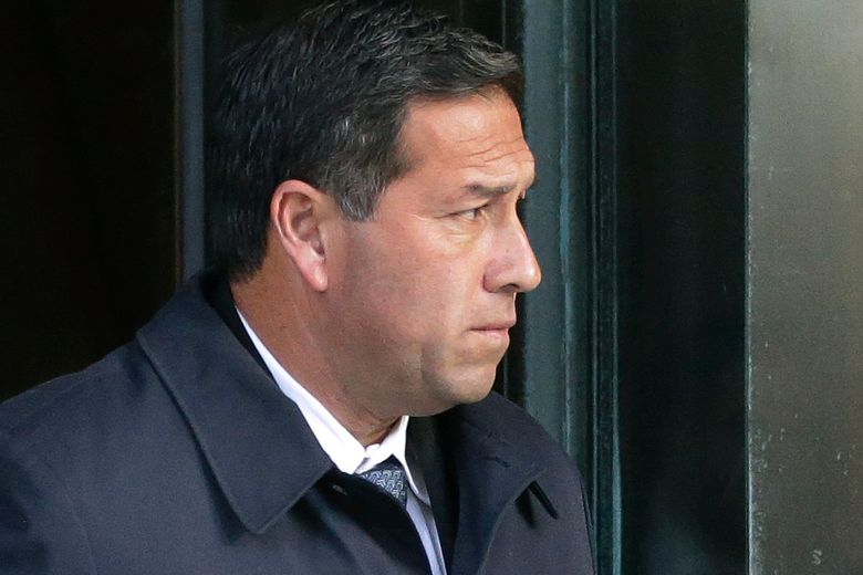 FILE – In this March 25, 2019, file photo Jorge Salcedo, former University of California at Los Angeles men's soccer coach, departs federal court in Boston after facing charges in a nationwide college admissions bribery scandal. Salcedo pleaded guilty in April 2020, and was sentenced to eight months behind bars Friday, March 19, 2021, for pocketing $200,000 in bribes to help applicants get into the school as bogus athletic recruits. (AP Photo/Steven Senne, File)