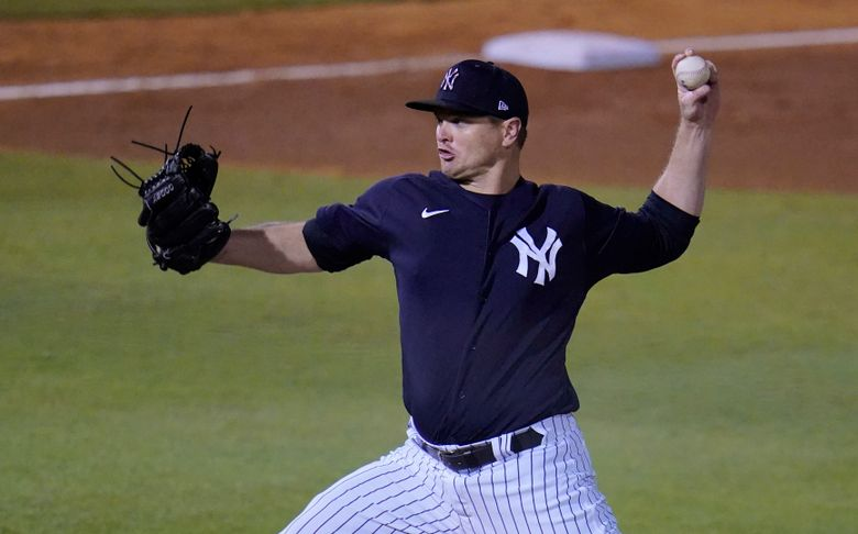 FILE – In this March 19, 2021, file photo, New York Yankees pitcher Justin Wilson delivers during the team's spring training baseball game against the Philadelphia Phillies in Tampa, Fla. Wilson became the Yankees' second left-handed reliever to get hurt during spring training, leaving Monday night's exhibition against Philadelphia due to tightness in his pitching shoulder. New York said Wilson will have an MRI on Tuesday. (AP Photo/Gene J. Puskar, File)