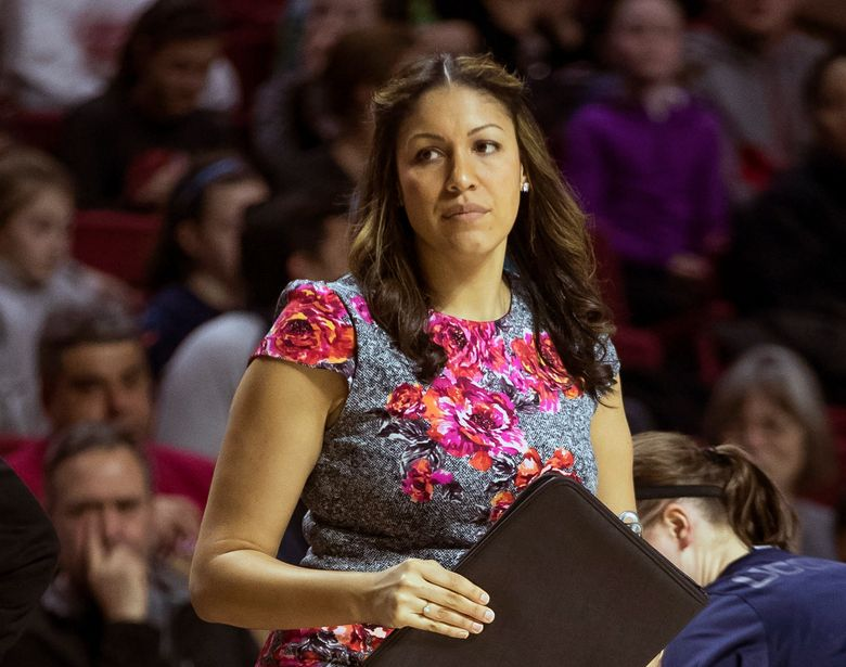 FILE – In this Feb. 1, 2017, file photo, Connecticut assistant coach Marisa Moseley looks on during the second half of an NCAA college basketball game against the Temple in Philadelphia. Wisconsin hired Boston University's Moseley as women's basketball coach as the Badgers attempt to rejuvenate a program that hasn't produced a winning season in a decade. Moseley was 45-29 at Boston University after working as an assistant on UConn coach Geno Auriemma's staff during five of the Huskies' national championship seasons (2010, 2013, 2014, 2015 and 2016). (AP Photo/Chris Szagola, File)
