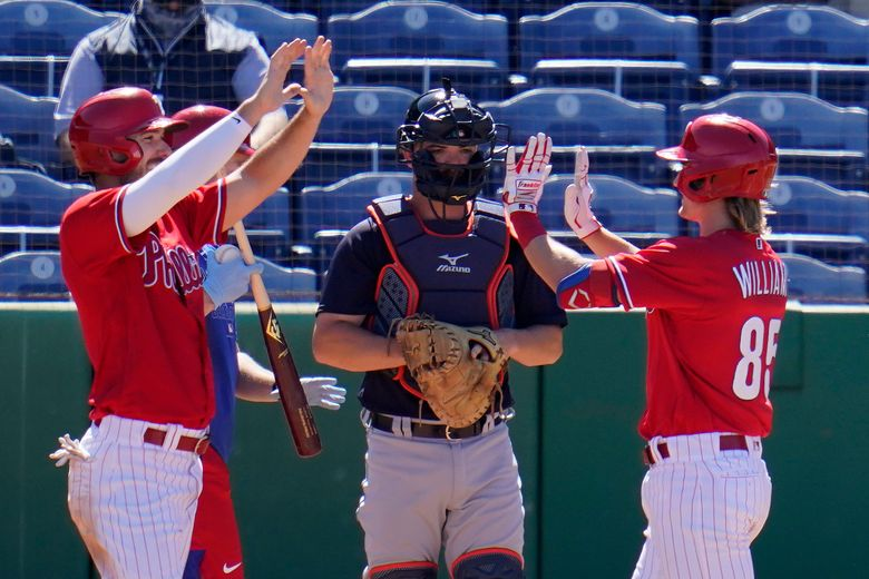 Philadelphia Phillies' Luke Williams (85) is greeted by Matt Joyce as he crosses home plate in front of Detroit Tigers catcher Jake Rogers after hitting a three-run home run off pitcher Buck Farmer during the fourth inning of a spring training exhibition baseball game at BayCare Ballpark in Clearwater, Fla., Wednesday, March 10, 2021. (AP Photo/Gene J. Puskar)