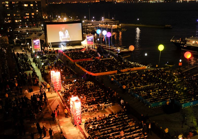 """FILE – People attend an outdoor screening  for """"The Union"""" at the opening night gala of the Tribeca Film Festival in New York on April 20, 2011. The Tribeca Film Festival said Monday, March 29, 2021, it plans to hold its 20th edition in-person and with outdoor screenings in June. (AP Photo/Evan Agostini, File)"""