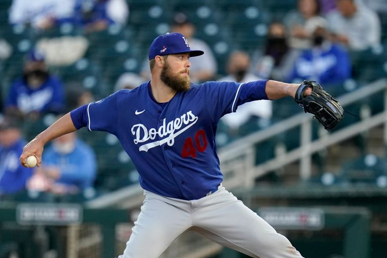 Los Angeles Dodgers starting pitcher Jimmy Nelson throws a pitch against the Cincinnati Reds during the first inning a spring training baseball game Tuesday, March 9, 2021, in Goodyear, Ariz. (AP Photo/Ross D. Franklin)