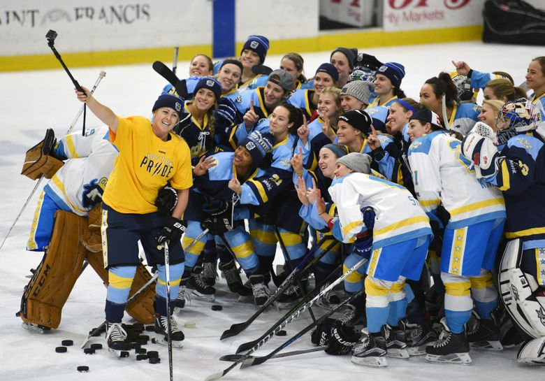 """FILE – In this Sunday, Jan. 24, 2016, file photo, National Women's Hockey League All-Star players take time for a """"selfie"""" before an all-star game at Harborcenter in Buffalo, N.Y. The National Women's Hockey League is adding a seventh team by expanding into Montreal next season, two people with direct knowledge of the league's board of governors' approved plan told The Associated Press. The people spoke to The AP on the condition of anonymity because they are not authorized to speak for the NWHL. League spokesman, Paul Krotz, would only say the NWHL had """"nothing to report regarding season seven expansion,"""" in an email sent late Monday, March 22, 2021.  (AP Photo/Gary Wiepert, File)"""