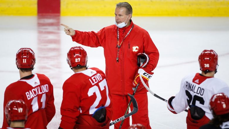 Calgary Flames head coach Geoff Ward gives instruction during a training camp practice in Calgary, Sunday, Jan. 10, 2021. (Jeff McIntosh/The Canadian Press via AP)