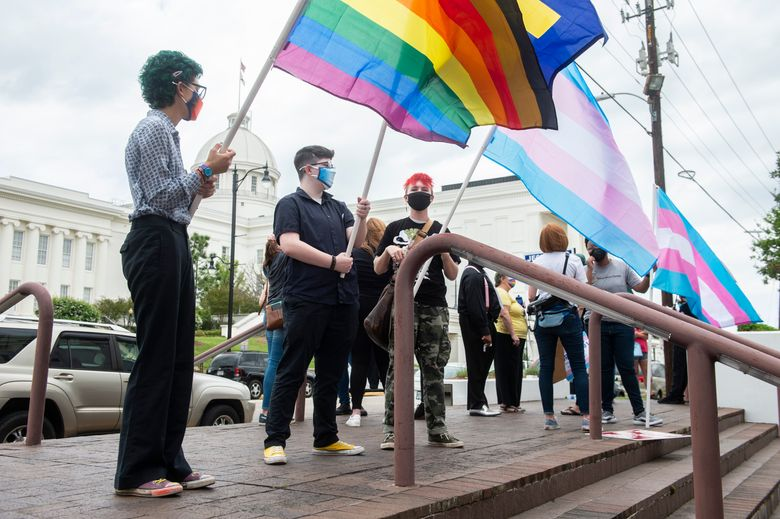 Protestors in support of transgender rights rally outside the Alabama State House in Montgomery, Ala., on Tuesday, March 30, 2021. (Jake Crandall/The Montgomery Advertiser via AP)