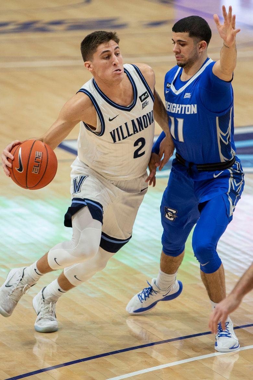 Villanova guard Collin Gillespie (2) moves around Creighton guard Marcus Zegarowski (11) during the first half of an NCAA college basketball game Wednesday, March 3, 2021, in Villanova, Pa. (AP Photo/Laurence Kesterson)