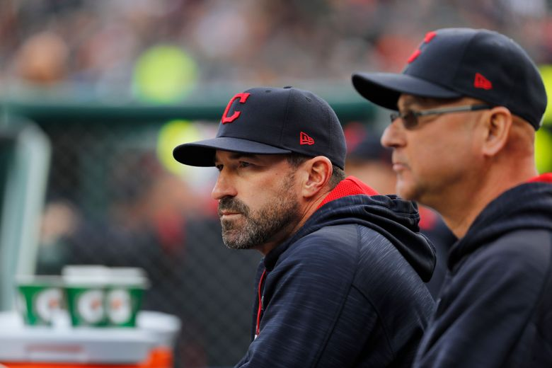 """FILE – Cleveland Indians pitching coach Mickey Callaway, left, watches with manager Terry Francona during the first inning of a baseball game against the Detroit Tigers, in Detroit, in this May 3, 2017, file photo. Indians manager Terry Francona said no one in the Cleveland organization """"covered up"""" for former pitching coach Mickey Callaway, who is under investigation by Major League Baseball following allegations of sexual harassment. In a story Tuesday, March 2, 2021, The Athletic reported that 12 current and former Indians employees have come forward in the last month to say the Indians were aware of Callaway's inappropriate behavior while he was their pitching coach from 2013-17. (AP Photo/Paul Sancya, File)"""