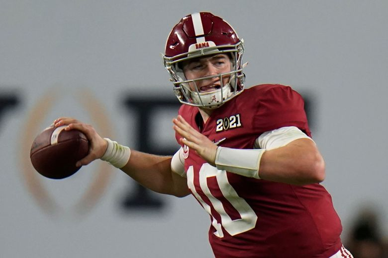 FILE – Alabama quarterback Mac Jones passes against Ohio State during the second half of an NCAA College Football Playoff national championship game in Miami Gardens, Fla., in this Monday, Jan. 11, 2021, file photo. Patrick Surtain II and Mac Jones had the spotlight at Alabama's Pro Day, Tuesday, March 23, 2021. (AP Photo/Chris O'Meara, File)