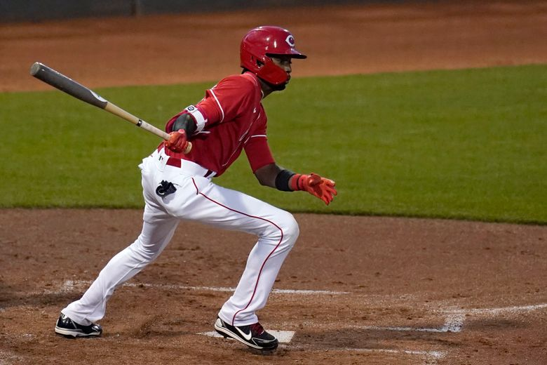 Cincinnati Reds' Dee Strange-Gordon watches his RBI double to right during the second inning of the team's spring training baseball game against the Texas Rangers on Wednesday, March 24, 2021, in Goodyear, Ariz. (AP Photo/Ross D. Franklin)