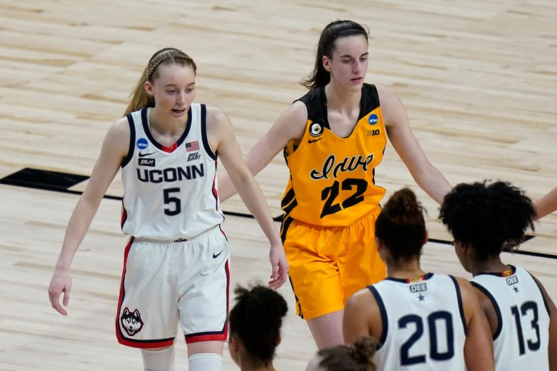 UConn guard Paige Bueckers (5) and Iowa guard Caitlin Clark (22) walk off the court after their college basketball game in the Sweet Sixteen round of the women's NCAA tournament at the Alamodome in San Antonio, Saturday, March 27, 2021. (AP Photo/Eric Gay)