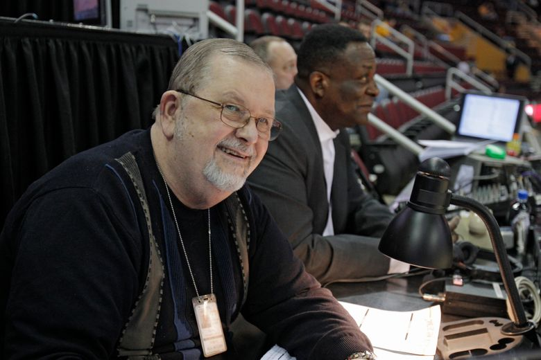FILE – In this March 27, 2011, file photo, Cleveland Cavaliers hall of fame broadcaster Joe Tait prepares to call an NBA basketball game between the Cavaliers and Atlanta Hawks in Cleveland. Tait, a longtime Cleveland sports broadcaster and voice of the Cavaliers for more than four decades, died Wednesday, Mach 10, 2021, the Cavaliers said in a statement. He was 83. Tait had recently gone into hospice care following a lengthy batter with kidney disease and liver cancer. (AP Photo/Mark Duncan)