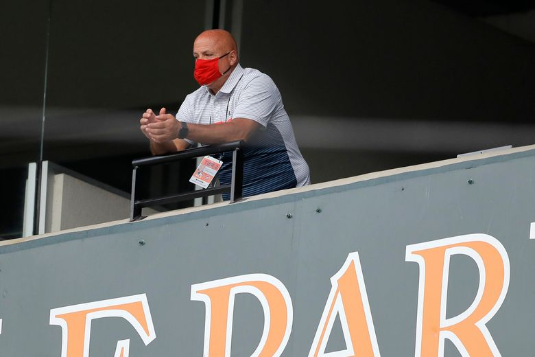 FILE – In this Aug. 14, 2020, file photo, Washington Nationals general manager Mike Rizzo looks on during the seventh inning in the continuation of a suspended baseball game between the Baltimore Orioles and the Nationals in Baltimore. On Wednesday, March 31, 2021, Rizzo said a player for the team has tested positive for COVID-19. Rizzo said that four teammates and a staff member have been quarantined on the eve of the start of the regular season after contact tracing. (AP Photo/Julio Cortez, File)