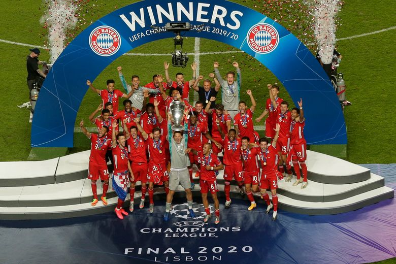FILE – In this file photo dated Sunday, Aug. 23, 2020, Bayern's goalkeeper Manuel Neuer lifts the trophy after the Champions League final soccer match between Paris Saint-Germain and Bayern Munich at the Luz stadium in Lisbon, Portugal.  The 2021 Champions League quarterfinals will feature rematches from two of the past three finals, with defending champion Bayern Munich drawn on Friday March 19, 2021, to face Paris Saint-Germain. (AP Photo/Manu Fernandez, FILE)