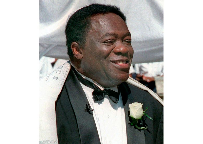 """FILE – Actor Yaphet Kotto appears on his wedding day in Baltimore, Md. on July 12, 1998. Kotto, the commanding actor of the James Bond film """"Live and Let Die"""" and as Lt. Al Giardello on the 90's NBC police drama """"Homicide: Life on the Street, died Monday, March 15, 2021 at age 81. Kotto's wife, Tessie Sinahon, announced his death Monday in a Facebook post. She said he died Monday in the Philippines. Kotto's agent, Ryan Goldhar, confirmed Kotto's death. (AP Photo/John Gillis, File)"""