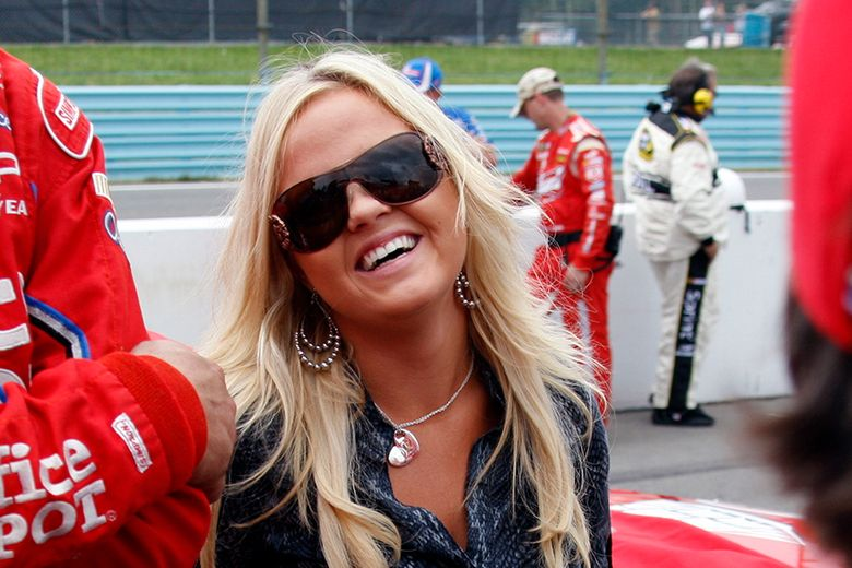 FILE – In this Aug. 9, 2009, file photo, American Sprint Car Series driver Jessica Zemken, now Jessica Friesen, smiles a rain delay at the NASCAR Sprint Cup Series' Heluva Good! Sour Cream Dips at The Glen auto race in Watkins Glen, N.Y. If Jessica Friesen, successfully qualifies for her first NASCAR national series event, she will join husband Stewart Friesen in the field for the Truck Series race Saturday night, March 27, 2021, at Bristol Motor Speedway. The Friesens would be the first husband and wife to compete in the same NASCAR event since 1998. (AP Photo/ David Duprey)