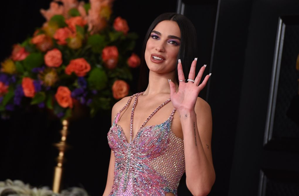 Dua Lipa arrives at the 63rd annual Grammy Awards at the Los Angeles Convention Center on Sunday, March 14, 2021. (Jordan Strauss / Invision / The Associated Press)