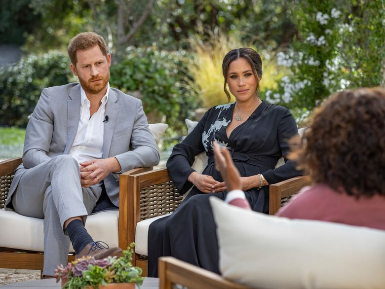 Prince Harry, left, and Meghan, Duchess of Sussex, in conversation with Oprah Winfrey. (Joe Pugliese/Harpo Productions via AP, file)