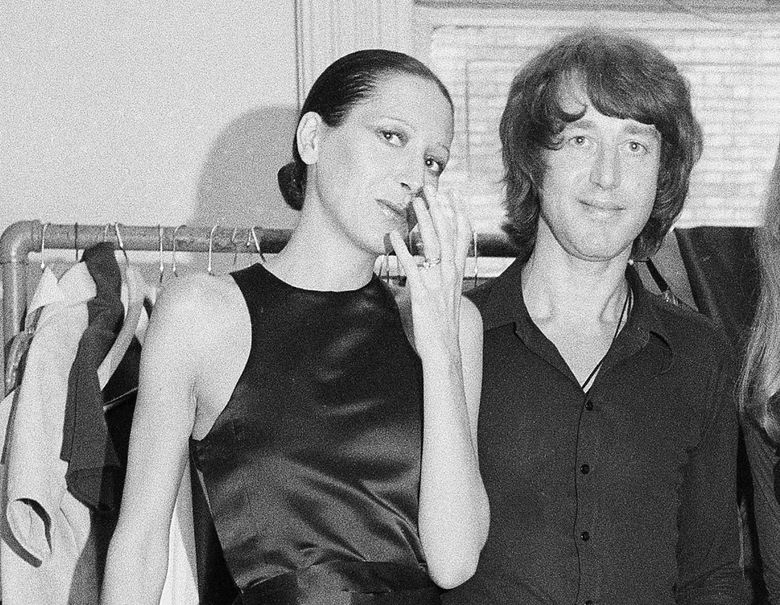 FILE – Elsa Peretti, left, poses with designer Halston after a fashion show in New York on June 15, 1970.  Famed jewelry designer Elsa Peretti, a formal Halston model turned Tiffany & Co. legend, is dead at age 80. According to a family statement, Peretti died Thursday night in her sleep at home in a small village outside Barcelona.  (AP Photo/Marty Lederhandler, File)