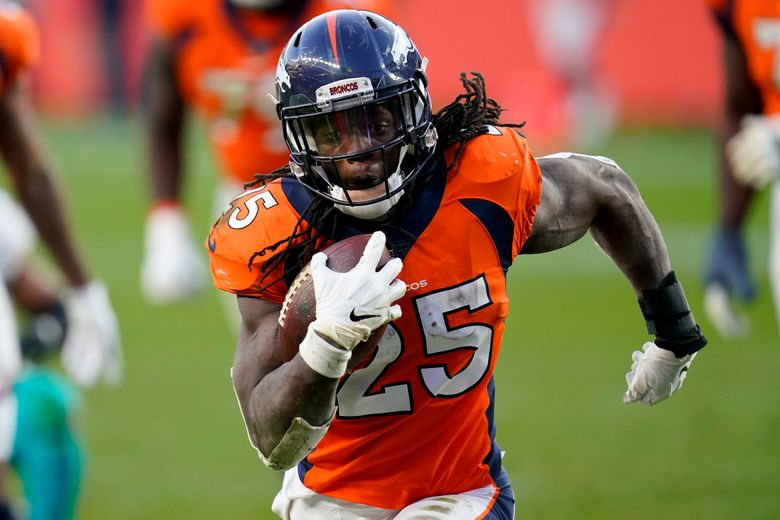 FILE – In this Nov. 22, 2020, file photo, Denver Broncos running back Melvin Gordon (25) runs for his second touchdown against the Miami Dolphins during the second half of an NFL football game in Denver. Gordon will likely avoid NFL discipline after his drunken driving charge was dismissed and he pleaded guilty in Denver County Court on Wednesday, March 10, 2021, to lesser charges of excessive speeding and reckless driving. (AP Photo/David Zalubowski, File)