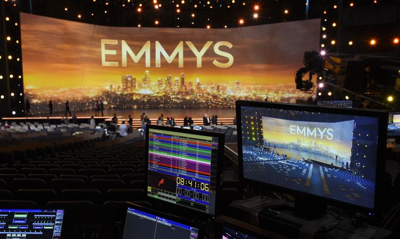 FILE – A video monitor displays the stage for Sunday's 71st Primetime Emmy Awards during Press Preview Day in Los Angeles on Sept. 19, 2019. The Emmy Awards will be held on Sept. 19 and air live on CBS. (Photo by Chris Pizzello/Invision/AP, File)