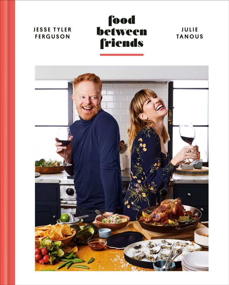 """This cover image shows """"Food Between Friends"""" by Jesse Tyler Ferguson and Julie Tanous. (Clarkson Potter via AP)"""