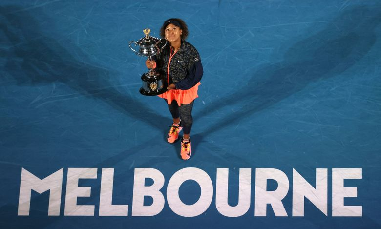 Japan's Naomi Osaka holds the Daphne Akhurst Memorial Cup after defeating United States Jennifer Brady in the women's singles final at the Australian Open tennis championship in Melbourne, Australia, Saturday, Feb. 20, 2021.(AP Photo/Hamish Blair)