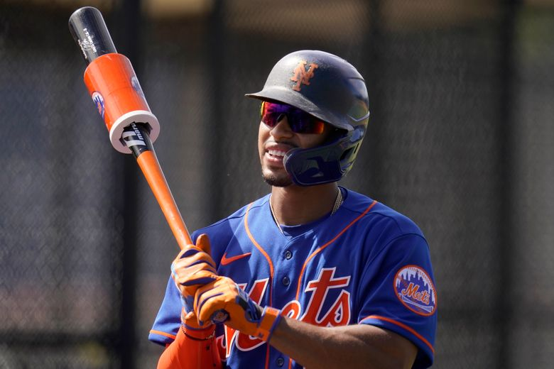 New York Mets' Francisco Lindor holds a bat during spring training baseball practice Tuesday, Feb. 23, 2021, in Port St. Lucie, Fla. (AP Photo/Jeff Roberson)