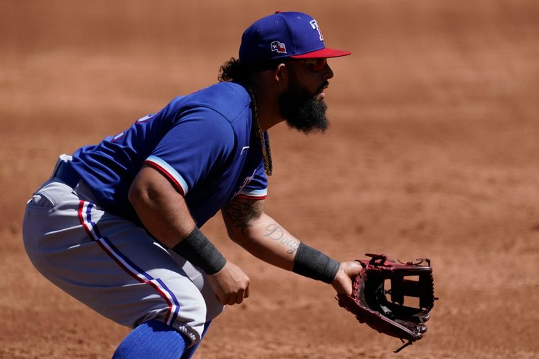 Texas Rangers second baseman Rougned Odor (12) stands at the ready during the third inning of a spring training baseball game against the Colorado Rockies Monday, March 22, 2021, in Scottsdale, Ariz. (AP Photo/Ashley Landis)