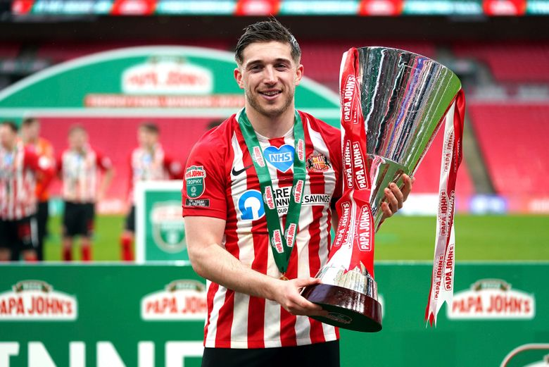 Sunderland's Lynden Gooch celebrates with the trophy after the EFL soccer final against Tranmere at Wembley Stadium, London, Sunday March 14, 2021. (John Walton/PA via AP)