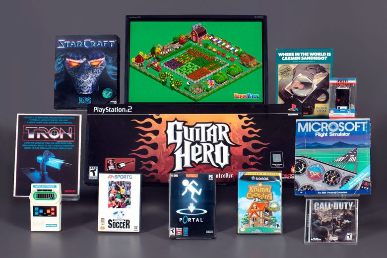 """This photo, provided by the Strong National Museum of Play, in Rochester, N.Y., Tuesday, March 16, 2021, shows 12 finalists for 2021 induction into the Video Game Hall of Fame. Included are: Nintendo's """"Animal Crossing,"""" Infinity Ward/Activision's """"Call of Duty,"""" Zynga's """"FarmVille,"""" """"FIFA International Soccer,"""" Harmonix's """"Guitar Hero,"""" Mattel Electronics' """"Mattel Football,"""" """"Microsoft Flight Simulator,"""" Namco/Atari's """"Pole Position,"""" Blizzard Entertainment's """"StarCraft,"""" Midway's """"Tran,"""" and Broderbund's """"Where in the World is Carmen San Diego?"""" (Strong National Museum of Play via AP)"""