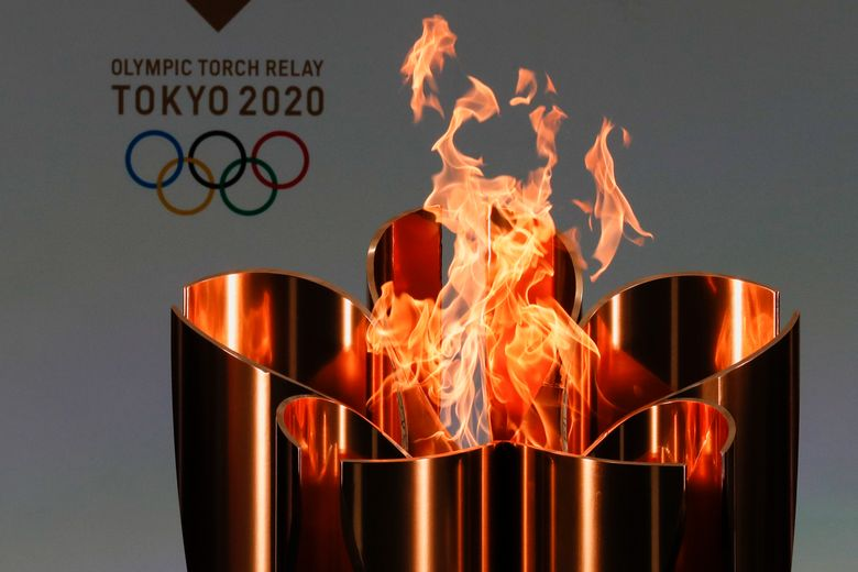FILE – In this March 25, 2021, file photo, the celebration cauldron is seen lit on the first day of the Tokyo 2020 Olympic torch relay in Naraha, Fukushima prefecture, northeastern Japan. The governor of Osaka prefecture said on Thursday that he wants to cancel the Olympic torch relay legs going through Osaka later this month. (Kim Kyung-Hoon/Pool Photo via AP, File)