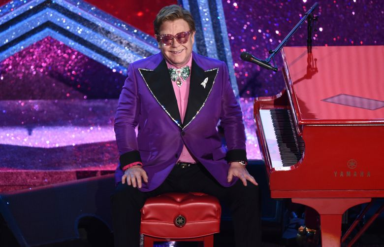 Elton John performs at the Oscars, Feb. 9, 2020, in Los Angeles. His long-running Oscar-night party has always been one of the hardest tickets to get, but now anyone can attend this year's online benefit event for $19.99.  (AP Photo/Chris Pizzello, File)