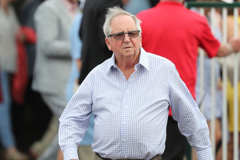FILE – Trainer Claude 'Shug' McGaughey is seen at Churchill Downs in Louisville, Ky., in this Wednesday, May 1, 2019, file photo. McGaughey will run heavily favored Greatest Honour in Saturday's Florida Derby at Gulfstream Park, one of the last major prep races for the Kentucky Derby. (AP Photo/Gregory Payan, File)